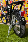 Black small bicycle isolated on colorful background — Stok fotoğraf