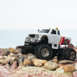Offroad truck drive along the beach — Stock Photo