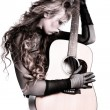 Rocker girl with acoustic guitar — Stock Photo #11407492