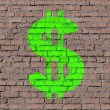 Dollar sign on brick seamless wall — Stock Photo