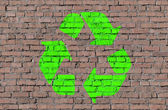 Eco sign on brick seamless wall — Stock Photo