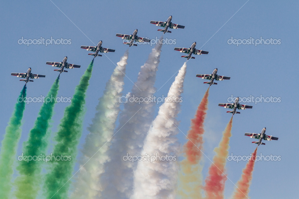 The Italian demonstration team Frecce Tricolori performing at Acireale, Catania - Sicily  Stock Photo #11077911