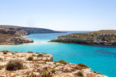 Pure crystalline water surface around an island (Lampedusa) — Stock Photo