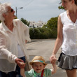 Three generations walking — Stock Photo