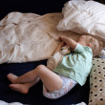 A child asleep on the floor — Stock Photo #11657409