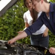 Stock Photo: A car mechanic at work