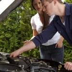 A car mechanic at work — Stock Photo