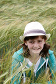 A young girl hiding in a corn field — Stock Photo
