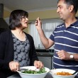 An Asian couple in the kitchen — Stock Photo