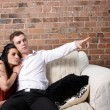 A young couple sitting close — Stock Photo #12305212