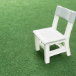 Royalty-Free Stock Photo: White child chair on green grass