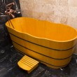 Stock Photo: Wooden bathtub in a bathroom