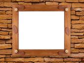 Dřevěný rám na kamenné zdi — Stock fotografie