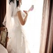Bride by the window — Stock Photo