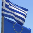 Flag of European union and Greek flag - Stock Photo