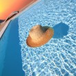 Straw hat in the pool. End of summer concept — Stock Photo