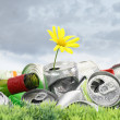 Garbage with growing daisy under storm clouds — Stock Photo