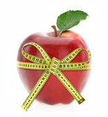Diet concept. Apple with measuring tape — Stock Photo