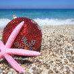 Christmas ornaments on the beach — Stock Photo