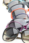 Collection of sunglasses on white background — Stock Photo