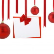 Christmas card and Christmas balls hanging on red ribbons — Stock Photo