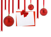 Christmas card and Christmas balls hanging on red ribbons — Zdjęcie stockowe
