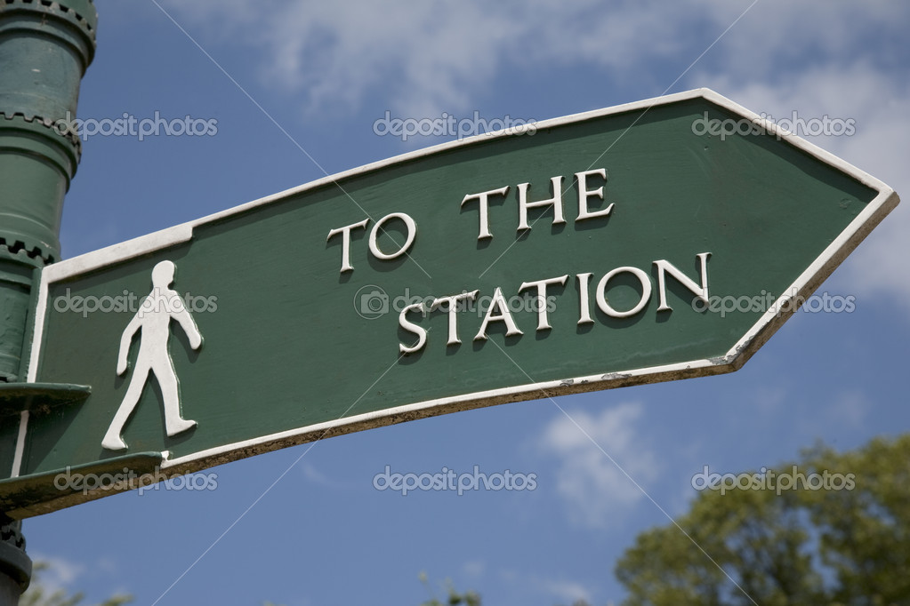 Green Station Sign against Blue Sky Background — Stock Photo #11831072