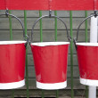 Three Red Hanging Buckets — Stock Photo