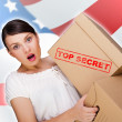 Portrait of young pretty woman with top secret package cardboard — Stock Photo #10774615
