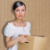Closeup portrait of a young woman with box — Stock Photo