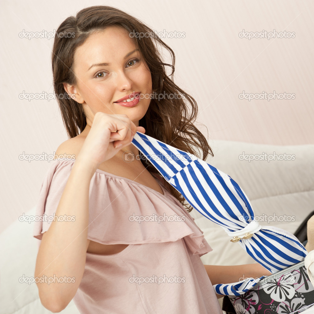Portrait of young woman preparing for big trip and vacation she can not wait and have a big fun with packing her props and clothes — Stock Photo #10774158
