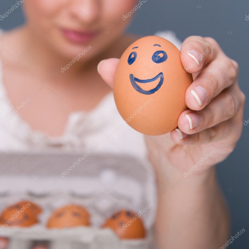 Portrait of young pretty business woman against grey background holding eggs with different emotions on their rawn faces. management conceptual photo. — Stock Photo #10779996