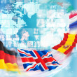Photo of different on world map, flags are flying to them — Stock Photo