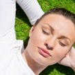 Young beautiful woman on the grass with closed eyes — Stock Photo #10948199