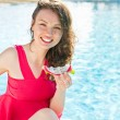 Beautiful young woman at a pool - Foto Stock