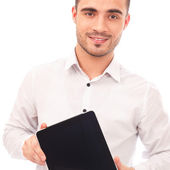 Man showing tablet computer screen smiling isolated on white bac — Stock Photo