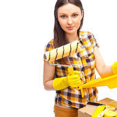 Young woman renovating her new home — Stock Photo
