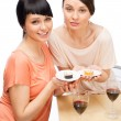 Stock Photo: Cheerful Women eating sushi rolls and drinking red wine