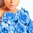 Gorgeous woman with blue flower dress over white background - Stock Photo
