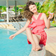 Beautiful young woman at a pool — Stock Photo #10995508