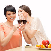 Cheerful Women eating sushi rolls and drinking red wine — Stock Photo
