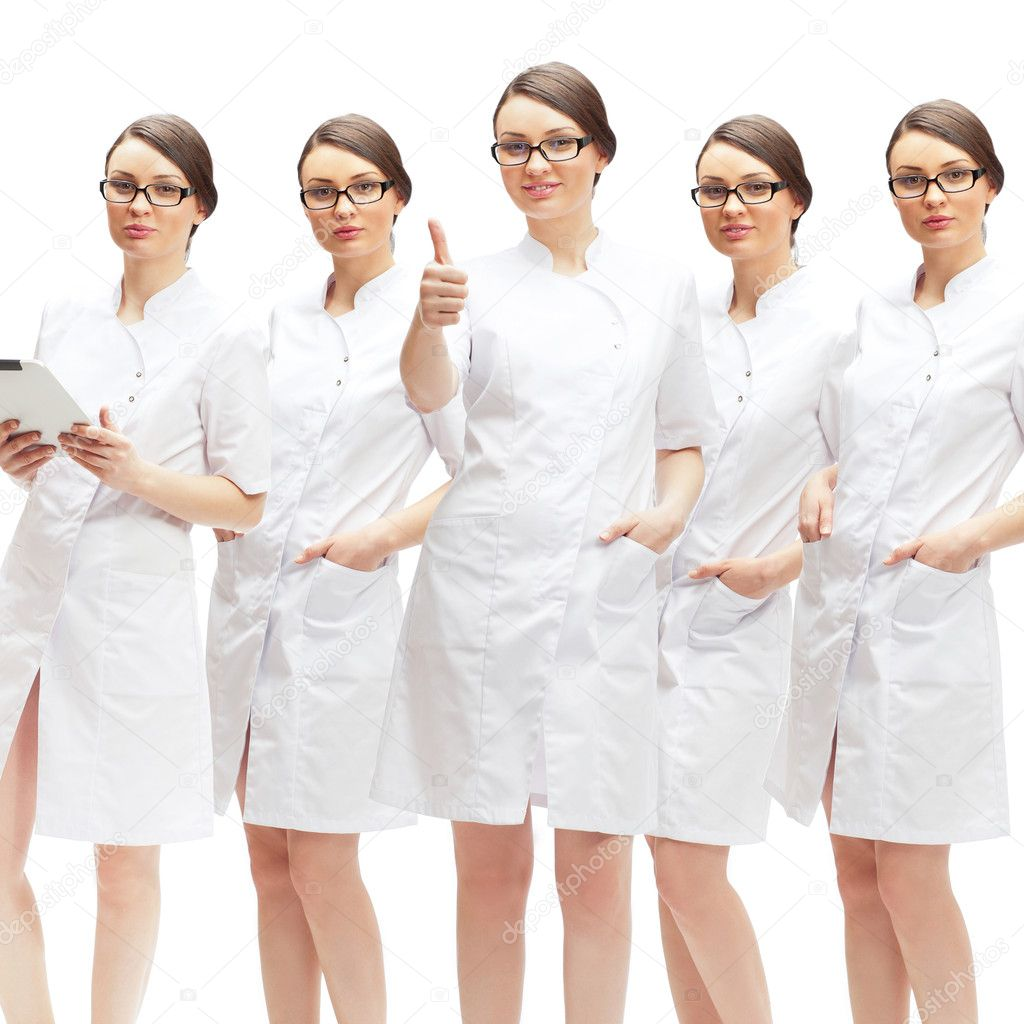 Portrait of young pretty doctor thumbs up with her clones in different poses isolated on white background — Stock Photo #10995430