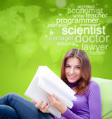 Young female student studying and thinking about future professi — Stock Photo