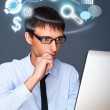 Adult business man working with his computer and different icons — Stock Photo