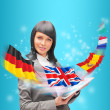 Stock Photo: Young woman wearing suit holding tablet computer. Flags of Europ