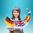 Young woman wearing suit holding tablet computer. Flags of Europ — Stock Photo
