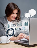 Young business woman working on her laptop. Different icons with — Stock Photo