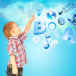 Happy little boy pointing up. Icons of different lessons flying near him. Primary education — Stock Photo #11346117