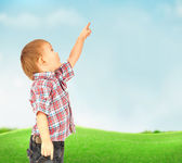 Portrait of happy joyful beautiful little boy outdoor at countryside — Stock Photo