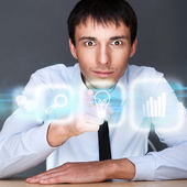 Business man working with his modern computer and virtual interface. Merge of technologies concept — Stock Photo